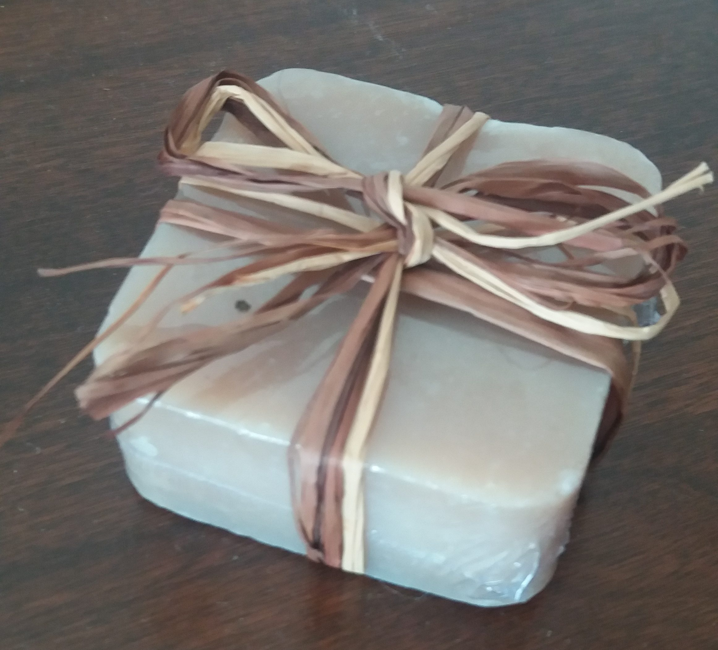 Vegan Maple Soap wrapped in plastic and with a straw bow string